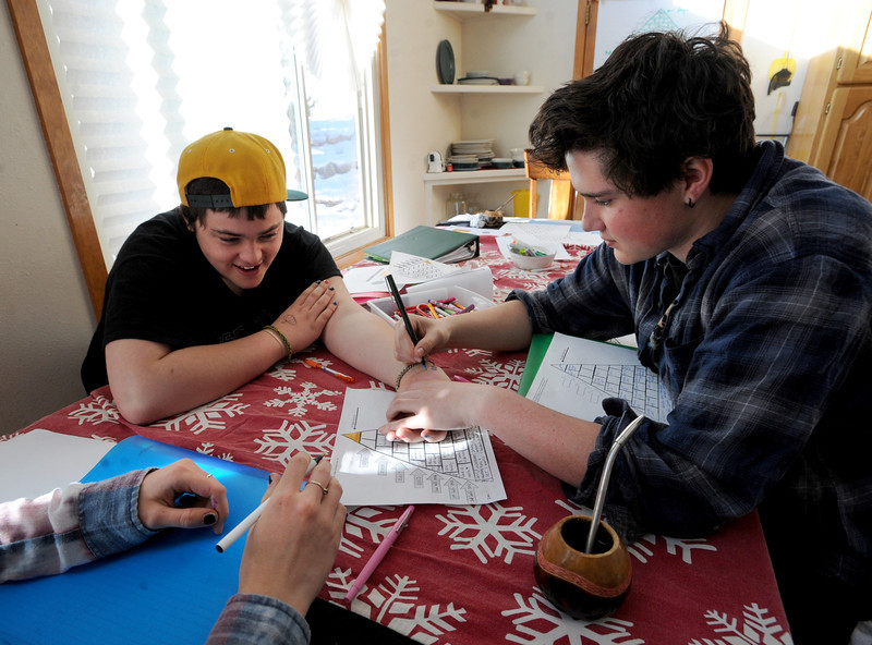 """Fire Mountain resident, Alex, has his arm drawn on by Evan, during some free time at the home.<br /> Fire Mountain Sober Home in Boulder is where teens ages 13-17 live for 4-14 months to hit the reset button,<br /> get sober,  get the life skills they need to succeed,<br /> become empowered and develop self-concept, and re-integrate back into their communities as responsible, contributing young adults.<br /> For more photos and a video from Fire Mountain, go to  <a href=""""http://www.dailycamera.com"""">http://www.dailycamera.com</a>.<br /> Cliff Grassmick  / January 4, 2013"""