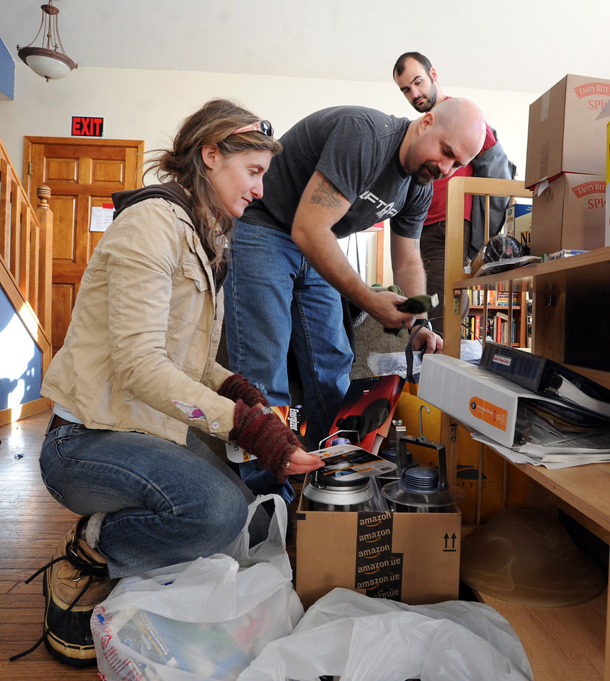 "Fire Mountain staff members, Megan Fettig, left, Aaron Huey, and Dylan Rivard, look over items they will be taking on their camping trip in Texas.<br /> Fire Mountain Sober Home in Boulder is where teens ages 13-17 live for 4-14 months to hit the reset button,<br /> get sober,  get the life skills they need to succeed,<br /> become empowered and develop self-concept, and re-integrate back into their communities as responsible, contributing young adults.<br /> For more photos and a video from Fire Mountain, go to  <a href=""http://www.dailycamera.com"">http://www.dailycamera.com</a>.<br /> Cliff Grassmick  / January 4, 2013"