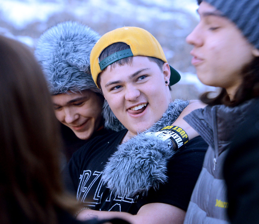 """Alex listens to the supportive comments from his peers during the initiation ceremony for himself and Claire.<br /> Fire Mountain Sober Home in Boulder is where teens ages 13-17 live for 4-14 months to hit the reset button,<br /> get sober,  get the life skills they need to succeed,<br /> become empowered and develop self-concept, and re-integrate back into their communities as responsible, contributing young adults.<br /> For more photos and a video from Fire Mountain, go to  <a href=""""http://www.dailycamera.com"""">http://www.dailycamera.com</a>.<br /> Cliff Grassmick  / January 4, 2013"""