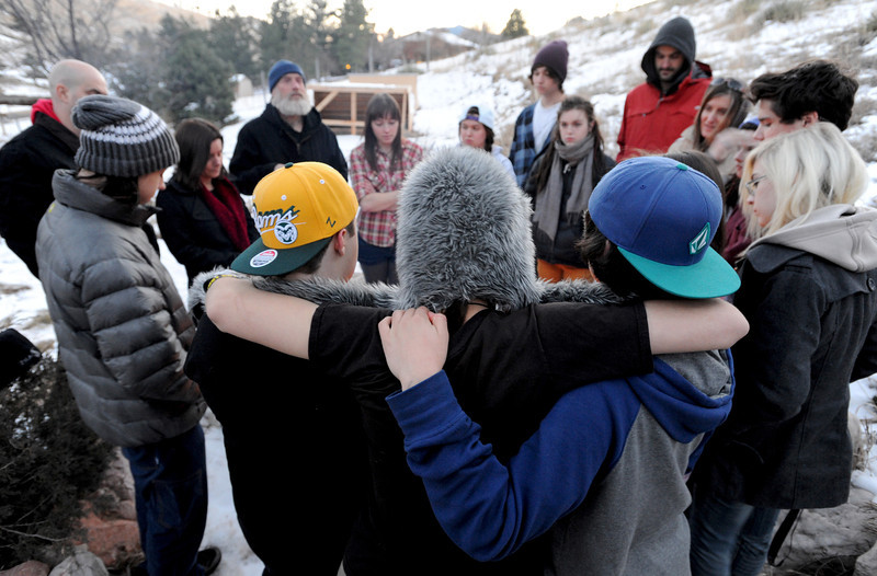 "Alex, left, Caleb, and Steve, all facing away,  show support for each other during an initiation ceremony.<br /> Fire Mountain Sober Home in Boulder is where teens ages 13-17 live for 4-14 months to hit the reset button,<br /> get sober,  get the life skills they need to succeed,<br /> become empowered and develop self-concept, and re-integrate back into their communities as responsible, contributing young adults.<br /> For more photos and a video from Fire Mountain, go to  <a href=""http://www.dailycamera.com"">http://www.dailycamera.com</a>.<br /> Cliff Grassmick  / January 4, 2013"
