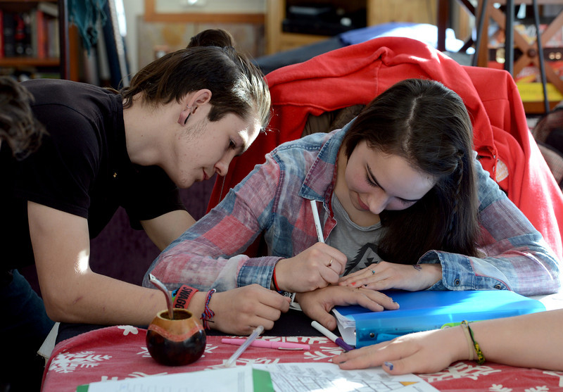 "Fire Mountain resident, Claire, right, draws a picture on the hand of Caleb, another resident.<br /> Fire Mountain Sober Home in Boulder is where teens ages 13-17 live for 4-14 months to hit the reset button,<br /> get sober,  get the life skills they need to succeed,<br /> become empowered and develop self-concept, and re-integrate back into their communities as responsible, contributing young adults.<br /> For more photos and a video from Fire Mountain, go to  <a href=""http://www.dailycamera.com"">http://www.dailycamera.com</a>.<br /> Cliff Grassmick  / January 4, 2013"