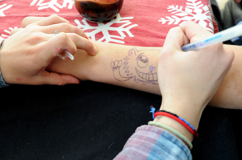 "Fire Mountain resident, Claire, draws a picture on the arm of Caleb, another resident of the program.<br /> Fire Mountain Sober Home in Boulder is where teens ages 13-17 live for 4-14 months to hit the reset button,<br /> get sober,  get the life skills they need to succeed,<br /> become empowered and develop self-concept, and re-integrate back into their communities as responsible, contributing young adults.<br /> For more photos and a video from Fire Mountain, go to  <a href=""http://www.dailycamera.com"">http://www.dailycamera.com</a>.<br /> Cliff Grassmick  / January 4, 2013"