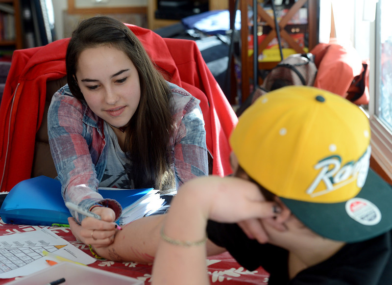 "Fire Mountain resident, Claire, left, draws a picture on the hand of resident, Alex.<br /> Fire Mountain Sober Home in Boulder is where teens ages 13-17 live for 4-14 months to hit the reset button,<br /> get sober,  get the life skills they need to succeed,<br /> become empowered and develop self-concept, and re-integrate back into their communities as responsible, contributing young adults.<br /> For more photos and a video from Fire Mountain, go to  <a href=""http://www.dailycamera.com"">http://www.dailycamera.com</a>.<br /> Cliff Grassmick  / January 4, 2013"