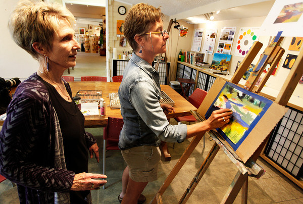 "Diana Tripp, left,  teaches Jocelyn Hunter, right, the art of painting with pastel, Friday, April 6, 2012, Lafayette.<br /> For more photos visit  <a href=""http://www.dailycamera.com"">http://www.dailycamera.com</a><br /> Photo by Derek Broussard"