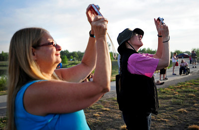 From left, Pamela Hallgring, of Longmont, and Alice Eccles, of Boulder, photograph the launching balloons Saturday morning at the Boulder County Fairgrounds for the Rhythm on the River celebration in Longmont, Colorado July 14, 2012. Rachel Woolf/ For the Daily Camera