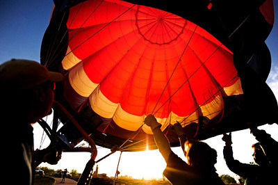 The Pepsi Won Balloon Team inflates their hot air balloon Saturday morning at the Boulder County Fairgrounds for the Rhythm on the River celebration in Longmont, Colorado July 14, 2012. Rachel Woolf/ For the Daily Camera
