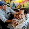 "Gerald Stopa, right, has a beer after work with the help of Imagine! staff member, Richard Lowe, at Twisted Pine Brewery in Boulder.<br /> For more photos and a video of Stopa, go to  <a href=""http://www.dailycamera.com"">http://www.dailycamera.com</a>.<br /> Cliff Grassmick / April 19, 2012"