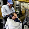 "Richard Lowe of Imagine!, helps Gerald Stopa get set up to count beer bottle and kegs at Twisted Pine Brewery in Boulder.<br /> For more photos and a video of Stopa, go to  <a href=""http://www.dailycamera.com"">http://www.dailycamera.com</a>.<br /> Cliff Grassmick / April 19, 2012"