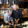 "Terry Kenyon, left, and Jonas Ceelen, both of Boulder, work together to build a custom guitar on Tuesday, Jan. 24, at the Jonas Guitar shop at 7648 Arapahoe Rd. in Boulder. For a video of the guitar building process go to  <a href=""http://www.dailycamera.com"">http://www.dailycamera.com</a><br />  Jeremy Papasso/ Camera"