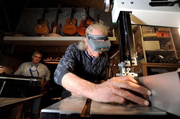"Jonas Ceelen, of Boulder, works to cut out the neck of a custom guitar for Terry Kenyon, also of Boulder, on Tuesday, Jan. 24, at the Jonas Guitar shop at 7648 Arapahoe Rd. in Boulder. For a video of the guitar building process go to  <a href=""http://www.dailycamera.com"">http://www.dailycamera.com</a><br />  Jeremy Papasso/ Camera"