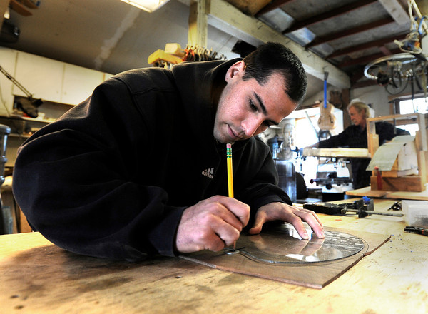 "Stuart Brooks, 23, of Boulder, stencils a design for his custom guitar on Tuesday, Jan. 24, at Jonas Guitar shop at 7648 Arapahoe Rd. in Boulder. For a video of the guitar building process go to  <a href=""http://www.dailycamera.com"">http://www.dailycamera.com</a><br />  Jeremy Papasso/ Camera"