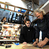 "Stuart Brooks, 23, of Boulder, left, works with Jonas Ceelen to make a custom guitar on Tuesday, Jan. 24, at Jonas Guitar shop at 7648 Arapahoe Rd. in Boulder. For a video of the guitar building process go to  <a href=""http://www.dailycamera.com"">http://www.dailycamera.com</a><br />  Jeremy Papasso/ Camera"