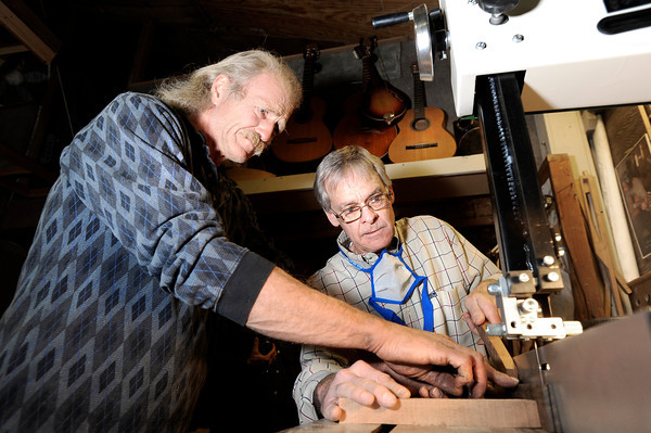 "Jonas Ceelen, of Boulder, left, helps Terry Kenyon, of Boulder, cut out the neck of his custom guitar on Tuesday, Jan. 24, at the Jonas Guitar shop at 7648 Arapahoe Rd. in Boulder. For a video of the guitar building process go to  <a href=""http://www.dailycamera.com"">http://www.dailycamera.com</a><br />  Jeremy Papasso/ Camera"