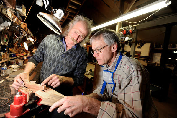 "Jonas Ceelen, of Boulder, left, explains how to build the neck of a guitar to his student Terry Kenyon, of Boulder, on Tuesday, Jan. 24, at the Jonas Guitar shop at 7648 Arapahoe Rd. in Boulder. For a video of the guitar building process go to  <a href=""http://www.dailycamera.com"">http://www.dailycamera.com</a><br />  Jeremy Papasso/ Camera"