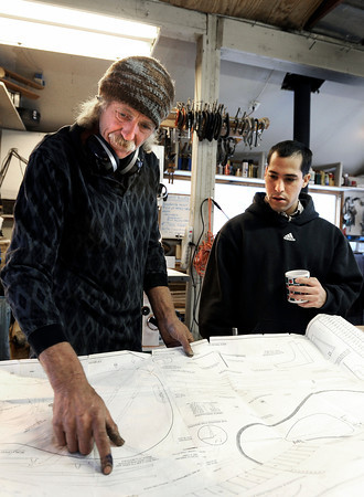 """Jonas Ceelen, of Boulder, left, and Stuart Brooks, also of Boulder, look at a blueprint for a custom guitar on Tuesday, Jan. 24, at Jonas Guitar shop at 7648 Arapahoe Rd. in Boulder. For a video of the guitar building process go to  <a href=""""http://www.dailycamera.com"""">http://www.dailycamera.com</a><br />  Jeremy Papasso/ Camera"""