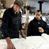 "Jonas Ceelen, of Boulder, left, and Stuart Brooks, also of Boulder, look at a blueprint for a custom guitar on Tuesday, Jan. 24, at Jonas Guitar shop at 7648 Arapahoe Rd. in Boulder. For a video of the guitar building process go to  <a href=""http://www.dailycamera.com"">http://www.dailycamera.com</a><br />  Jeremy Papasso/ Camera"