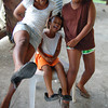 be1127kellidepriest2.jpg Dowanika Ephraim, 9, left, Jemima Joseph, 3, and  Pauliann Hippolyte, 8, try on some of Kelli DePriest's shoes at her home in Choiseul Village, St. Lucia, West Indies. DePreist was giving away most her clothes before returning to Colorado's cold climate and the girls had a ball throwing a fashion show with her wardrobe.