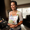 Kelli DePriest, holds a plaque made for her by her landlord during her 3 year stint with the Peace Corps in St Lucia The West Indies. She was photographed in her Broomfield home.<br />  November 23, 2011.<br /> Photo by Paul Aiken / The Camera