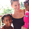 be1127kellidepriest3.jpg Broomfield High and Colorado State University grad Kelli DePriest with Nicole Placide, 1 1/2, and Dowanika Ephraim, 9, at DePreist's going-away party after serving 39 months with the Peace Corps in Choiseul Village, St. Lucia, West Indies.