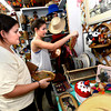From left to right Leslie and Clair Nebeker look for items for Clair's new apartment at the Lafayette Collectibles and Flea Market on Tuesday April 21, 2012. The two are sisters.<br /> Cheryl and Bill Hopkins started the Lafayette Collectibles and Flea Market in 1990. Tuesday April 21, 2012.<br /> <br /> Photo by Paul Aiken / The Boulder Camera