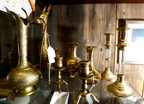 A sample of brass wares including candle holders at the Lafayette Collectibles and Flea Market.<br /> Cheryl and Bill Hopkins started the Lafayette Collectibles and Flea Market in 1990. Tuesday April 21, 2012.<br /> <br /> Photo by Paul Aiken / The Boulder Camera