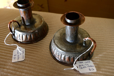 19th century tin candle holders at Lafayette Collectibles and Flea Market Cheryl and Bill Hopkins started the Lafayette Collectibles and Flea Market in 1990. Tuesday April 21, 2012.  Photo by Paul Aiken / The Boulder Camera