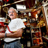 Jim Lhotak as run a both in the Lafayette Collectibles and Flea Market for over a year. Here he holds a hand grain grinder.<br /> Cheryl and Bill Hopkins started the Lafayette Collectibles and Flea Market in 1990. Tuesday April 21, 2012.<br /> <br /> Photo by Paul Aiken / The Boulder Camera
