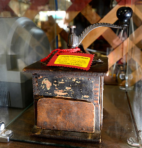 A mid 1800's coffee grinder at the Lafayette Collectibles and Flea Market Cheryl and Bill Hopkins started the Lafayette Collectibles and Flea Market in 1990. Tuesday April 21, 2012.  Photo by Paul Aiken / The Boulder Camera
