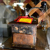 A mid 1800's coffee grinder at the Lafayette Collectibles and Flea Market<br /> Cheryl and Bill Hopkins started the Lafayette Collectibles and Flea Market in 1990. Tuesday April 21, 2012.<br /> <br /> Photo by Paul Aiken / The Boulder Camera