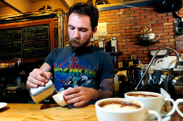 LATTE<br /> Adam Westlake pours lattes at The Cup in Boulder.<br /> Photo by Marty Caivano/Oct. 25, 2011