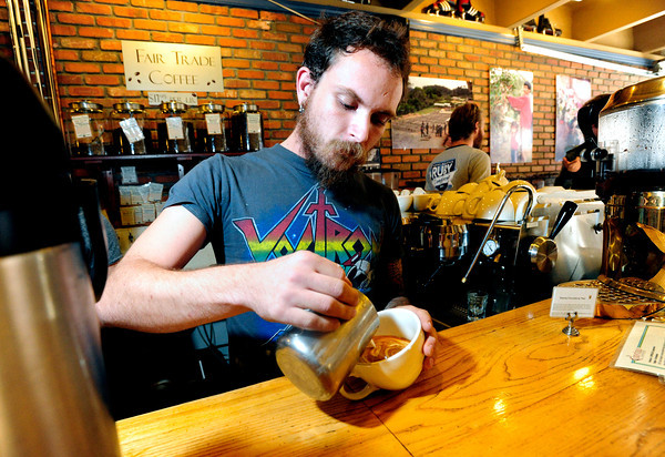 LATTE<br /> Barista Adam Westlake pours a latte at The Cup in Boulder.<br /> Photo by Marty Caivano/Oct. 25, 2011