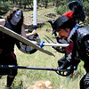 "F0931LARP11.jpg Lore Master David McMillen, right, playing Athos the Musketeer, is hit by morb Jen Allgood while her and other morbs attack McMillen and the rest of his Live Action Role Playing team during a LARPing event at Heil Ranch North of Boulder on Saturday, Aug 1, 2009.   Watch the video at  <a href=""http://www.dailycamera.com"">http://www.dailycamera.com</a>.<br /> <br /> Photo by Mara Auster/Daily Camera"