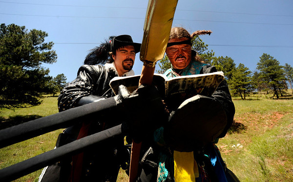 "F0931LARP8.jpg David McMillen, acting as Athos the Musketeer, left, and Dominic Stott, acting as Chun, stop to look over the International Fantasy Gaming Society rulebook on the Live Action Role Playing course during a LARPing event at Heil Ranch, North of Boulder on Saturday, Aug 1, 2009.   Watch the video at  <a href=""http://www.dailycamera.com"">http://www.dailycamera.com</a>.<br /> <br /> Photo by Mara Auster/Daily Camera"