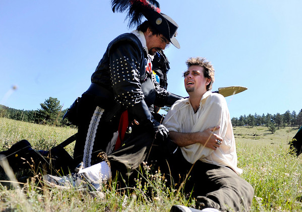 "F0931LARP17.jpg Lore Master David McMillen, left, playing Athos the Musketeer consuls Danny Dupree as he asks McMillen and the rest of his Live Action Role Playing team to find his family that the morbs took during a LARPing event at Heil Ranch North of Boulder on Saturday, Aug 1, 2009.   Watch the video at  <a href=""http://www.dailycamera.com"">http://www.dailycamera.com</a>.<br /> <br /> Photo by Mara Auster/Daily Camera"