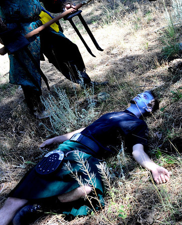 "F0931LARP2.jpg Morb Danny Dupree lays on the ground after being ""killed"" by Dominic Stott, top left, and Derek Euchler, not pictured, during a Live Action Role Playing event at Heil Ranch North of Boulder on Saturday, Aug 1, 2009.  Dupree's character disintegrated after being killed, leaving a magical necklace.  Watch the video at  <a href=""http://www.dailycamera.com"">http://www.dailycamera.com</a>.<br /> <br /> Photo by Mara Auster/Daily Camera"