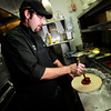 "West Flanders Brewing Company Executive Chef Jamie Lucas ladles on the sauce for the Boulder restaurant's Marti Gras pizza. September 21  2012.<br /> For more photos of the pizza go to  <a href=""http://www.coloradodaily.com"">http://www.coloradodaily.com</a><br /> Photo by Paul Aiken / The Camera"