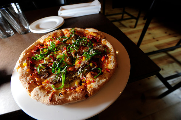 "West Flanders Brewing Company Executive Chef Jamie Lucas' and the Boulder restaurant's Marti Gras pizza. September 21  2012.<br /> For more photos of the pizza go to  <a href=""http://www.coloradodaily.com"">http://www.coloradodaily.com</a><br /> Photo by Paul Aiken / The Camera"