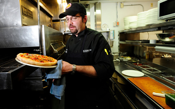 "West Flanders Brewing Company Executive Chef Jamie Lucas pulls the  Boulder restaurant's Marti Gras pizza out of the oven. September 21  2012.<br /> For more photos of the pizza go to  <a href=""http://www.coloradodaily.com"">http://www.coloradodaily.com</a><br /> Photo by Paul Aiken / The Camera"