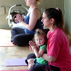 "Carrie Hill, right, starts class with her daughter Emily, 17 months, during the  Mommy and Me class at Yo Mama Yoga on Tuesday May 28, 2010. At top is Amanda Nuku with her son Dzinuvi Nuku 8 weeks old. For a video and more photos of the class go to  <a href=""http://www.dailycamera.com"">http://www.dailycamera.com</a>. <br /> Photo by Paul Aiken /"