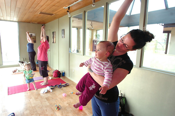 """Katie Houle and her daughter Lia Houle, 10 months participate in the Mommy and Me class at Yo Mama Yoga on Tuesday May 28, 2010. For a video and more photos of the class go to  <a href=""""http://www.dailycamera.com"""">http://www.dailycamera.com</a><br /> Photo by Paul Aiken /"""