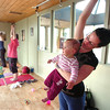 "Katie Houle and her daughter Lia Houle, 10 months participate in the Mommy and Me class at Yo Mama Yoga on Tuesday May 28, 2010. For a video and more photos of the class go to  <a href=""http://www.dailycamera.com"">http://www.dailycamera.com</a><br /> Photo by Paul Aiken /"