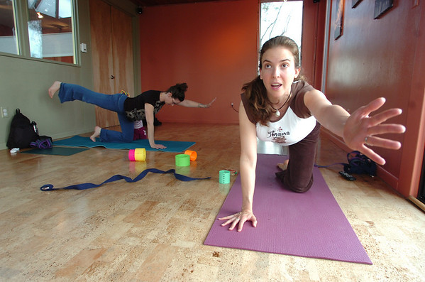 """Katie Wise leads the Mommy and Me class at Yo Mama Yoga on Tuesday May 28, 2010. At top is Katie Houle with her daughter Lia. For a video and more photos of the class go to  <a href=""""http://www.dailycamera.com"""">http://www.dailycamera.com</a>. <br /> Photo by Paul Aiken /"""