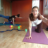 "Katie Wise leads the Mommy and Me class at Yo Mama Yoga on Tuesday May 28, 2010. At top is Katie Houle with her daughter Lia. For a video and more photos of the class go to  <a href=""http://www.dailycamera.com"">http://www.dailycamera.com</a>. <br /> Photo by Paul Aiken /"