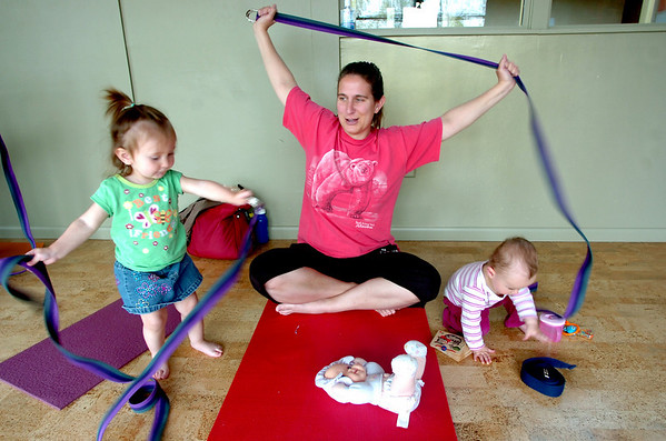 """Carrie Hill, center, with her daughter Emily, 17 months, at left, and Lia Houle, 10 months, Mommy and Me class at Yo Mama Yoga on Tuesday May 28, 2010. For a video and more photos of the class go to  <a href=""""http://www.dailycamera.com"""">http://www.dailycamera.com</a>. Lia Houle's mom Katie was participating in the class.<br /> Photo by Paul Aiken /"""