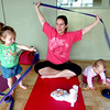 "Carrie Hill, center, with her daughter Emily, 17 months, at left, and Lia Houle, 10 months, Mommy and Me class at Yo Mama Yoga on Tuesday May 28, 2010. For a video and more photos of the class go to  <a href=""http://www.dailycamera.com"">http://www.dailycamera.com</a>. Lia Houle's mom Katie was participating in the class.<br /> Photo by Paul Aiken /"