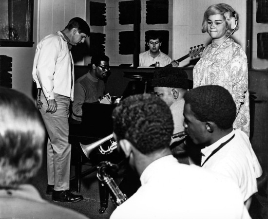 MUSCLE SHOALS AL - CIRCA 1967:  R and B singer Etta James recording at Fame Studios with Rick Hall, Marvell Thomas, David Hood and the Memphis Horns circa 1967 in Muscle Shoals, Alabama. Courtesy BIFF