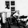 From left: Wilson Pickett, Muscle Shoals Rhythm Section player Jimmy Johnson, and Clarence Carter. Pickett and Carter were among many R&B artists who recorded hits in Muscle Shoals.<br /> <br /> The Muscle Shoals Sound Studio was formed in Muscle Shoals, Alabama, in 1969 when musicians Barry Beckett (keyboards), Roger Hawkins (drums), Jimmy Johnson (guitar) and David Hood (bass) (called The Swampers) left FAME Studios to create their own studio. The Muscle Shoals Sound Rhythm Section, as they became known, was the first rhythm section to own its own studio and, eventually, its own publishing and production companies. The distinctive accompaniment and arrangements have been heard on a tremendous number of legendary recordings, including those from Wilson Pickett, Aretha Franklin, and the Staple Singers amongst others. Many artists have recorded hit songs and complete albums at the studio.