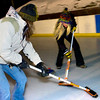 "Dory Johnson at left and Deb Dandrea sweep in front of a rock during play of the Nederland Curling Club at the NedRINK - Nederland Ice & Racquet Park on Monday February 15, 2010.<br /> Photo by Paul Aiken / The Camera<br /> Watch a video fo the Nederland Curling Club at  <a href=""http://www.dailycamera.com"">http://www.dailycamera.com</a>"