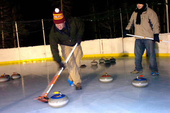 "Doug Jones and Matt Flynn sweep in front of a rock during play of the Nederland Curling Club at the NedRINK - Nederland Ice & Racquet Park on Monday February 15, 2010.<br /> Photo by Paul Aiken / The Camera<br /> Watch a video and see more photos of the Nederland Curling Club at  <a href=""http://www.dailycamera.com"">http://www.dailycamera.com</a>"