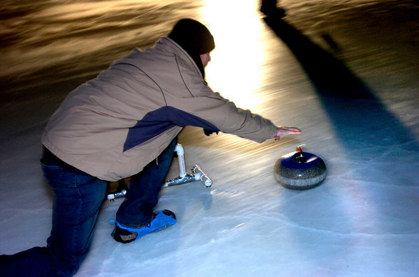 """Matt Flynn delivers a rock during play of the Nederland Curling Club at the NedRINK - Nederland Ice & Racquet Park on Monday February 15, 2010.<br /> Photo by Paul Aiken / The Camera<br /> Watch a video and see more photos of the Nederland Curling Club at  <a href=""""http://www.dailycamera.com"""">http://www.dailycamera.com</a>"""
